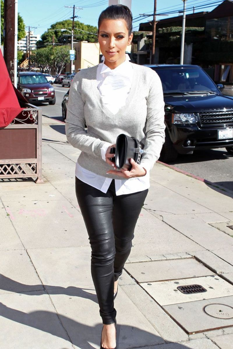 Kim Kardashian in leather pants and high heels