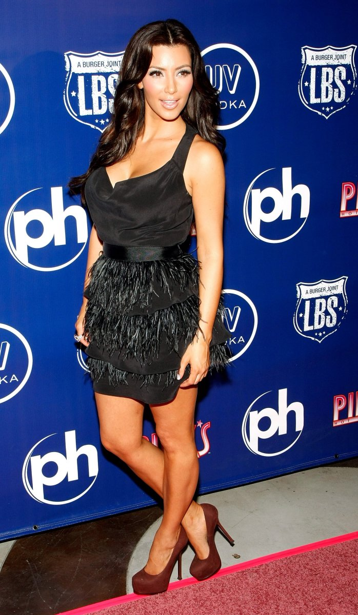 Kim Kardashian in a little black dress and high heels