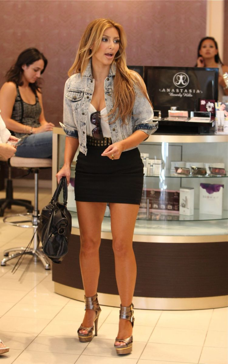 Kim Kardashian shopping in a black mini skirt and gladiator  high heels