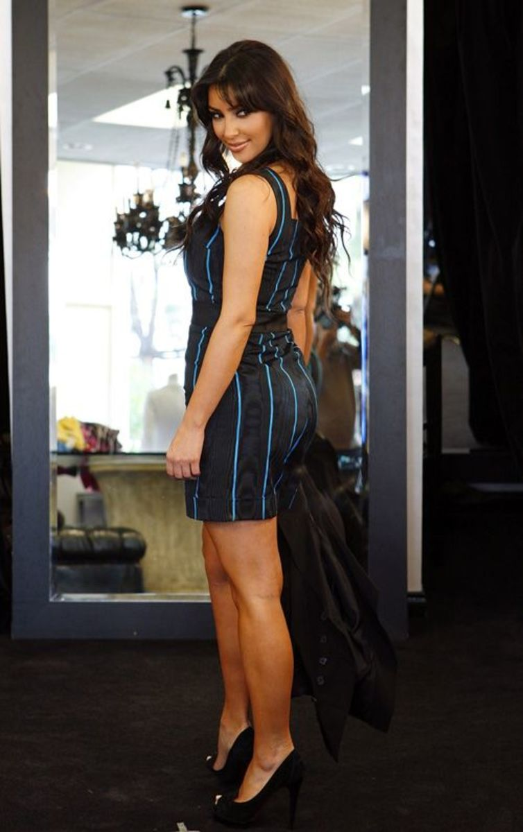 Kim Kardashian wearing a romper and high heels