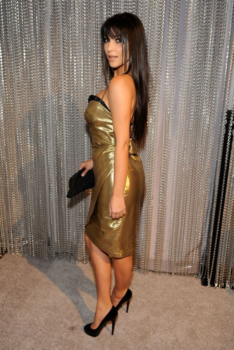 Kim Kardashian wearing sexy  a strapless dress and high heels