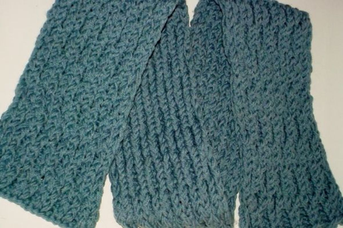 Honeycomb stitch scarf done on the pink Knifty Knitter loom using 2 strands of blue yarn as one.