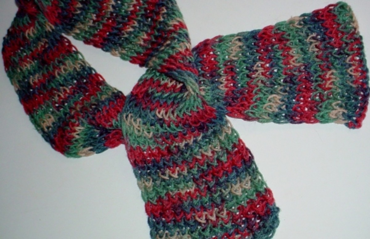 "Eight wrap scarf done in a single strand of medium weight yarn. The multicolor yarn in this photo reminds me of jelly bean colors. So, I named this the ""jelly bean"" scarf. It looks great in the spring with a denim jacket."