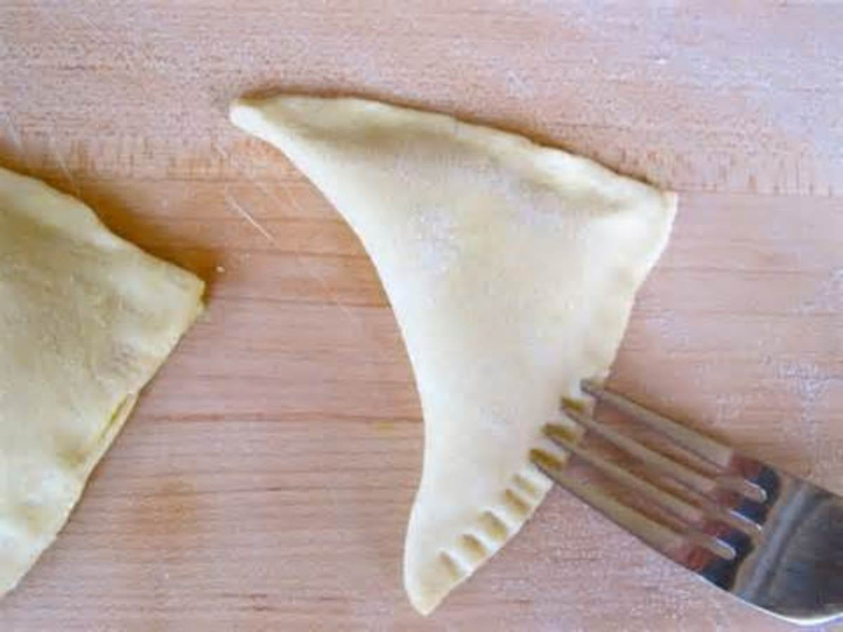 make a triangle out of dough and crimp edges