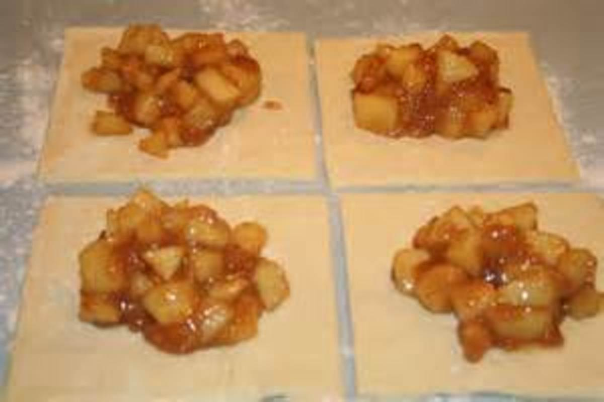 cut puff pastry dough in squares and fill with fruit