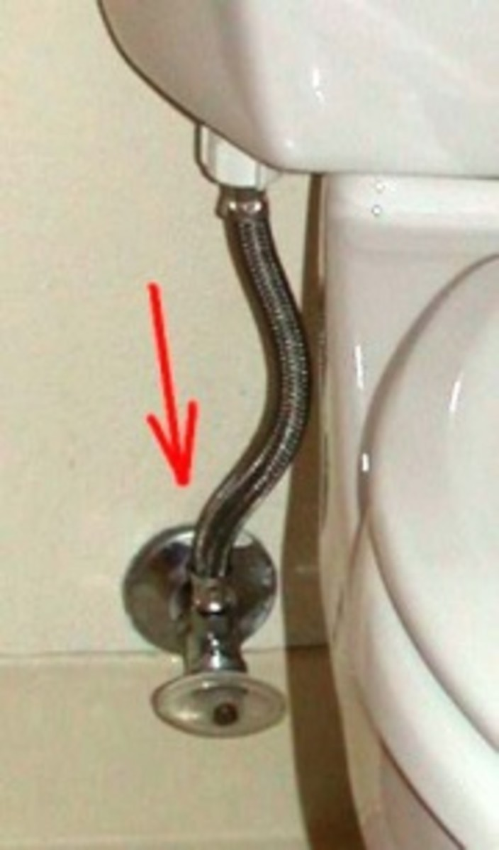 Red arrow points to the connection nut at the supply valve. There is a 2nd connection at the base of the toilet tank (visible in photo).