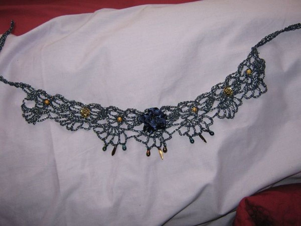 I embellished this crochet lace choker with fabric roses and beads.