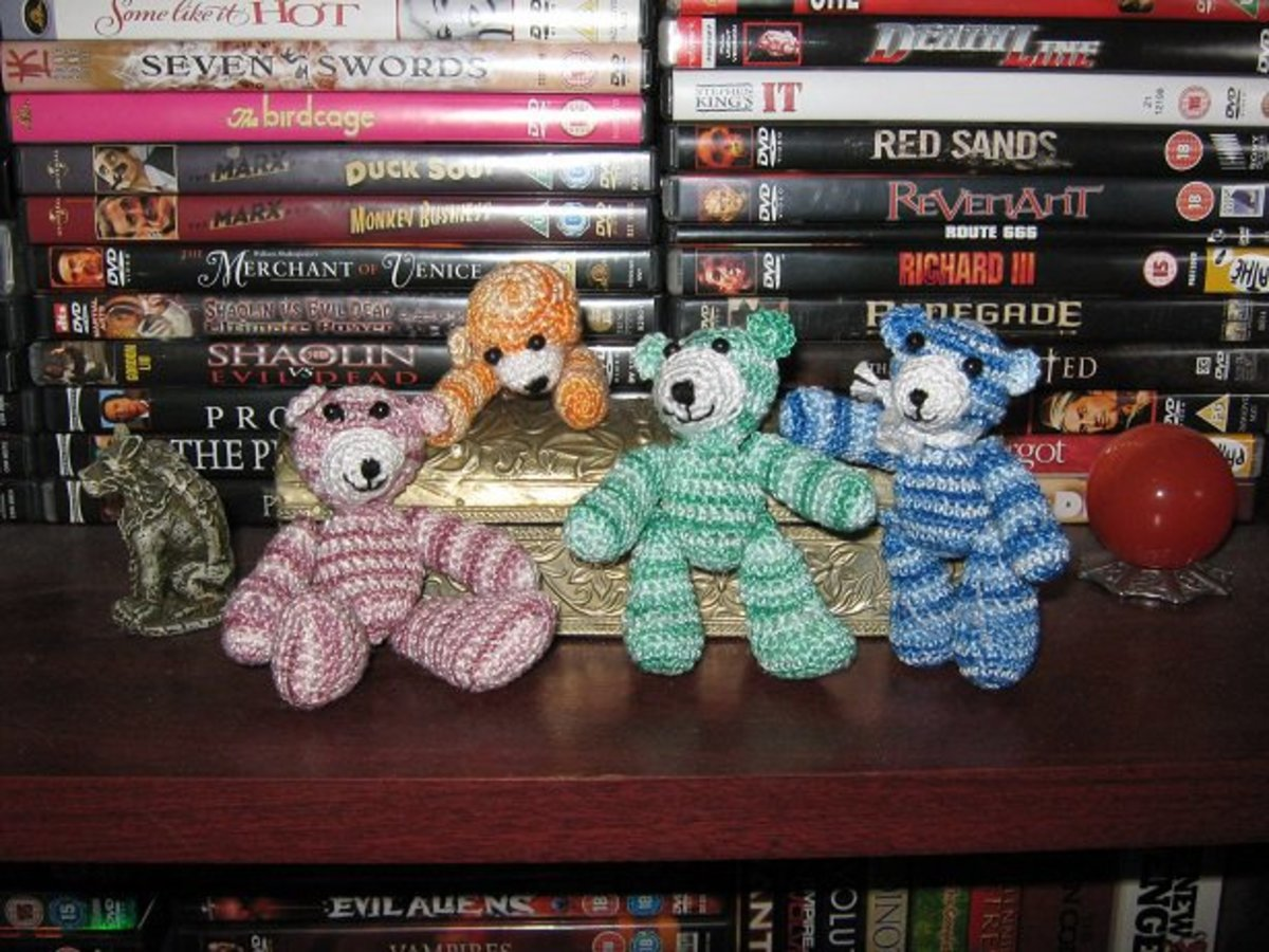 A collection of thread bears I made from the pattern on the lens How To Make a Thread Bear.