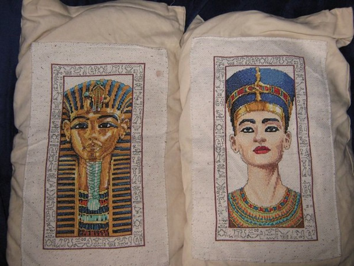 I cross stitched these Egyptian heads from a kit, then made plain oatmeal linen cushions to mount them on.