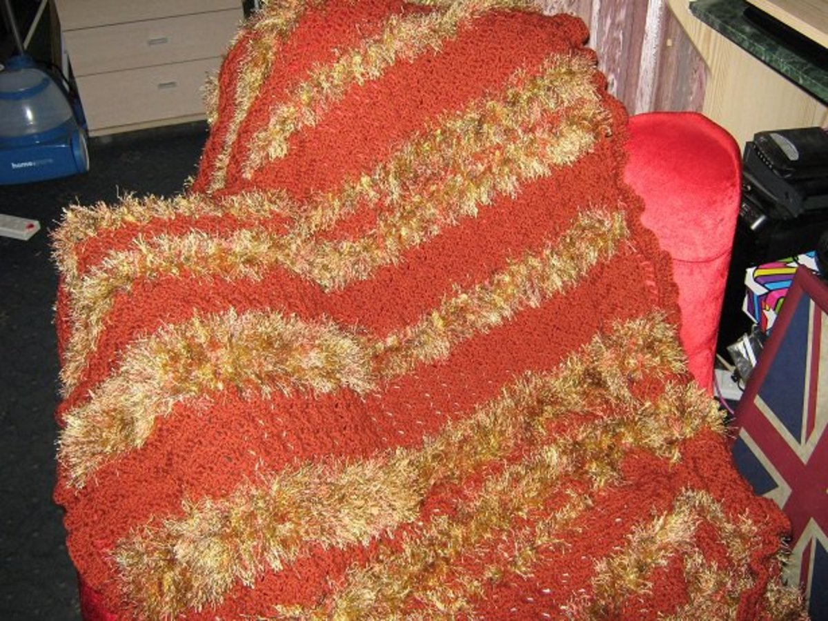 Autumn Afghan: a soft, warm blanket I crocheted using a variety of yarns including funky fur.