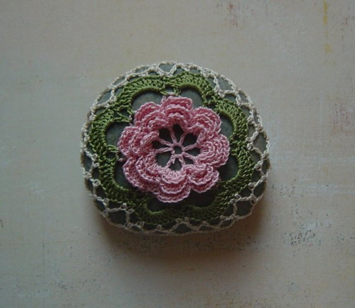 Crocheted flower lace stone by Monicaj.