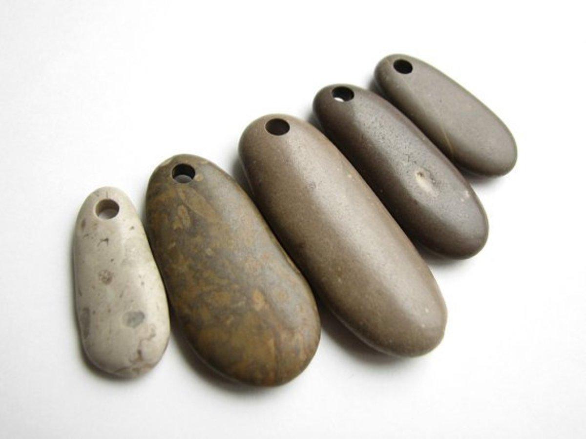 Stone pendants by StoneHood on Etsy.