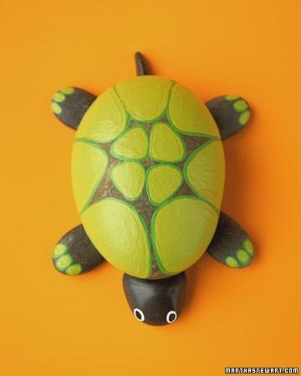 Paint a rock turtle.