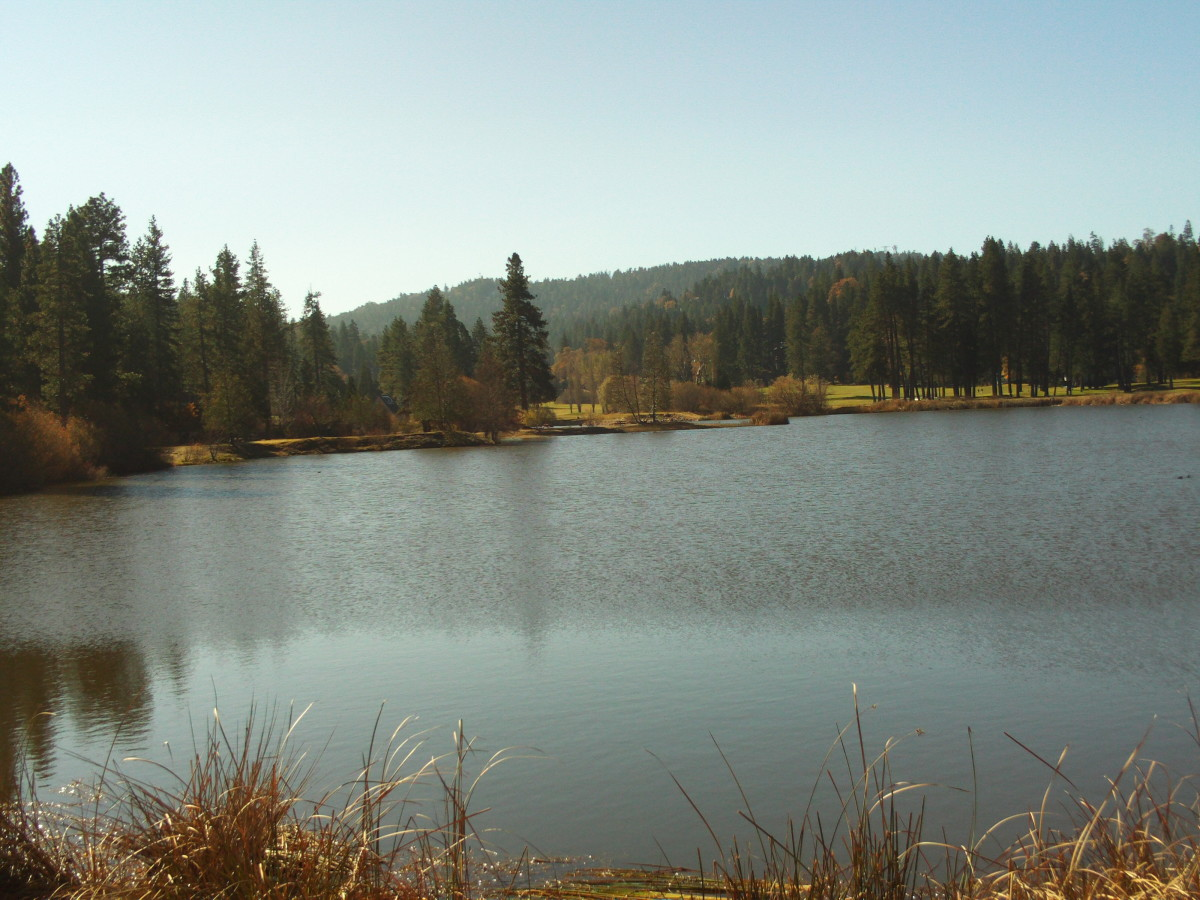 A long shot of Grass Valley Lake with the surrounding mountains in the distance.