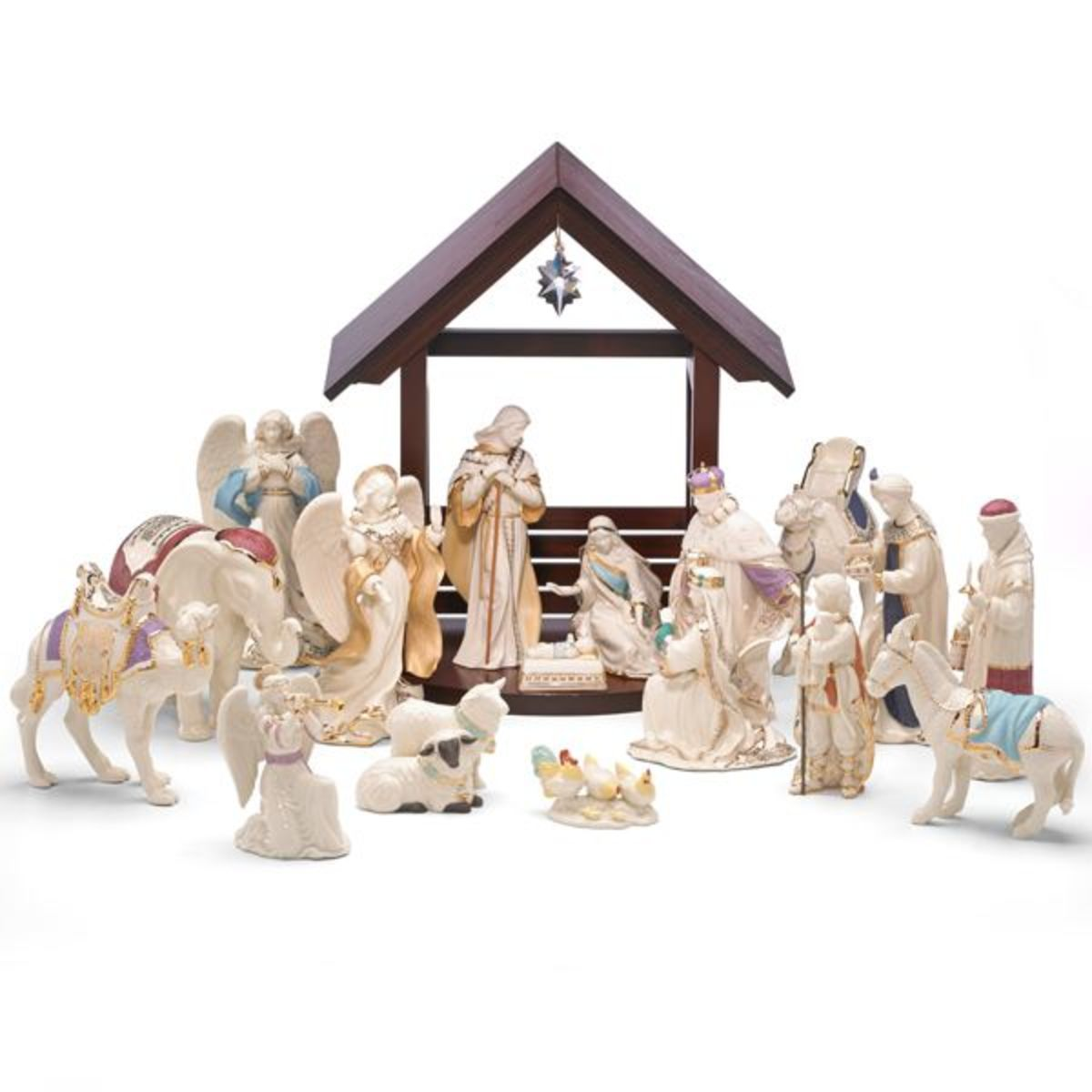 nativity set by Lenox with Mary, Joseph and baby Jesus and several others in white porcelain with gold