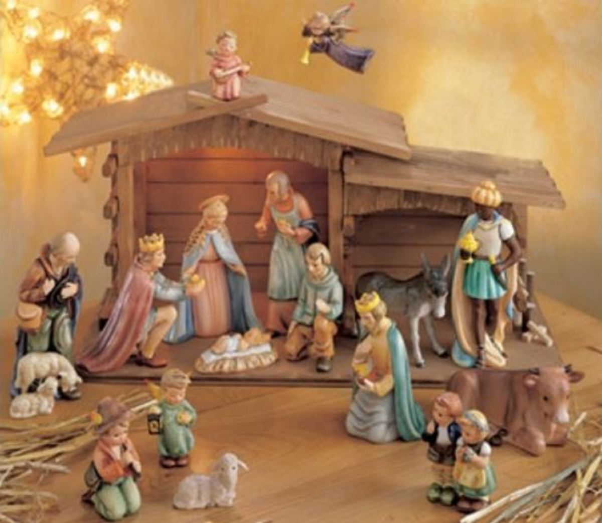 beautiful Hummel Nativity Set in soft pastels complete with wooden manger and porcelain star and angle above the manger