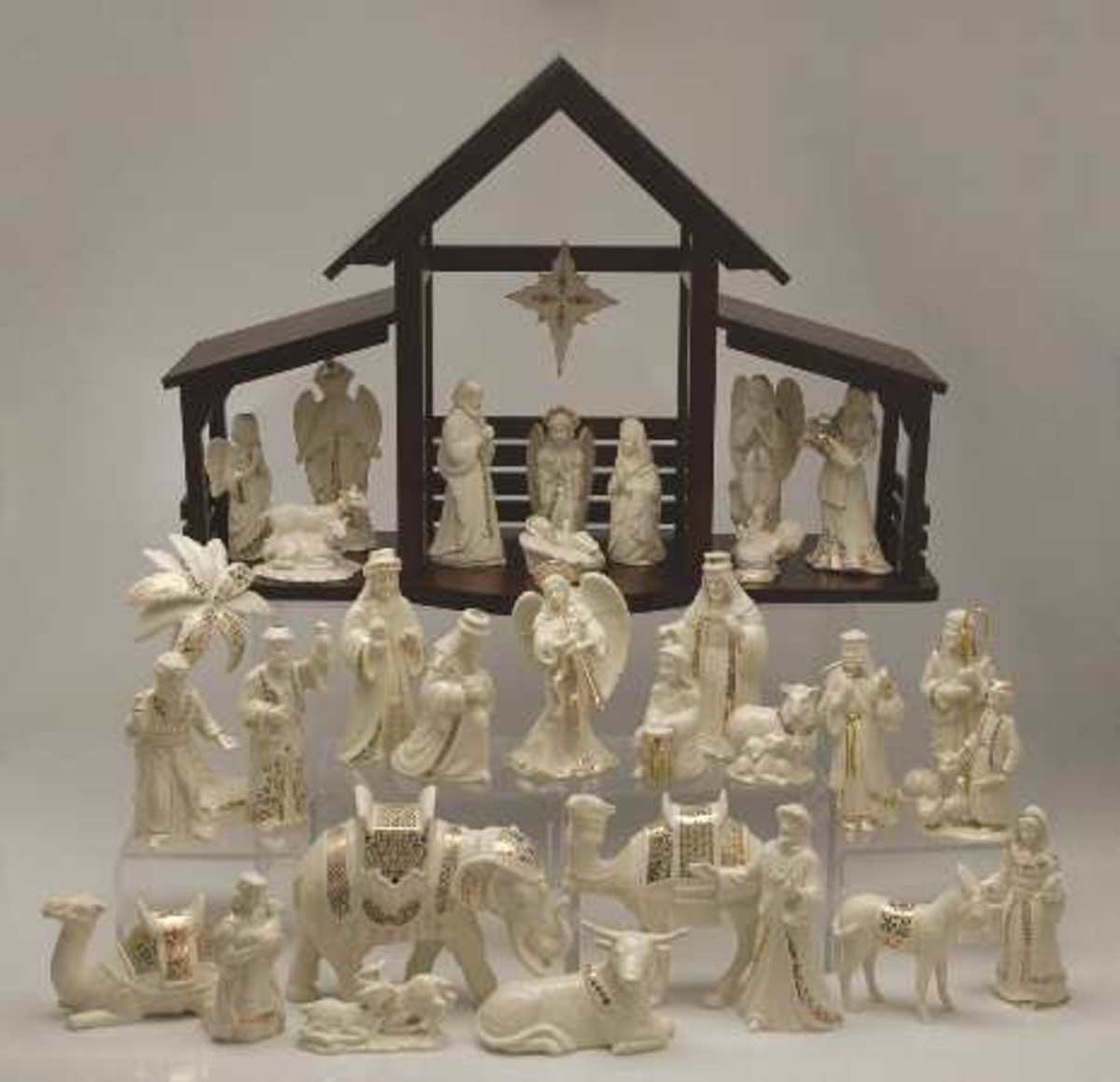 beautiful white nativity set by Lennox complete with wooden manger