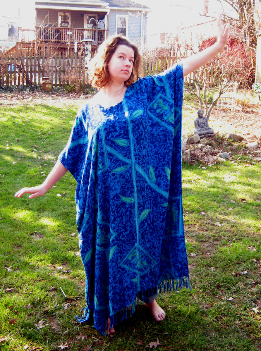 This lovely young woman shows how the Western style kaftan is made of a large rectangular piece of fabric