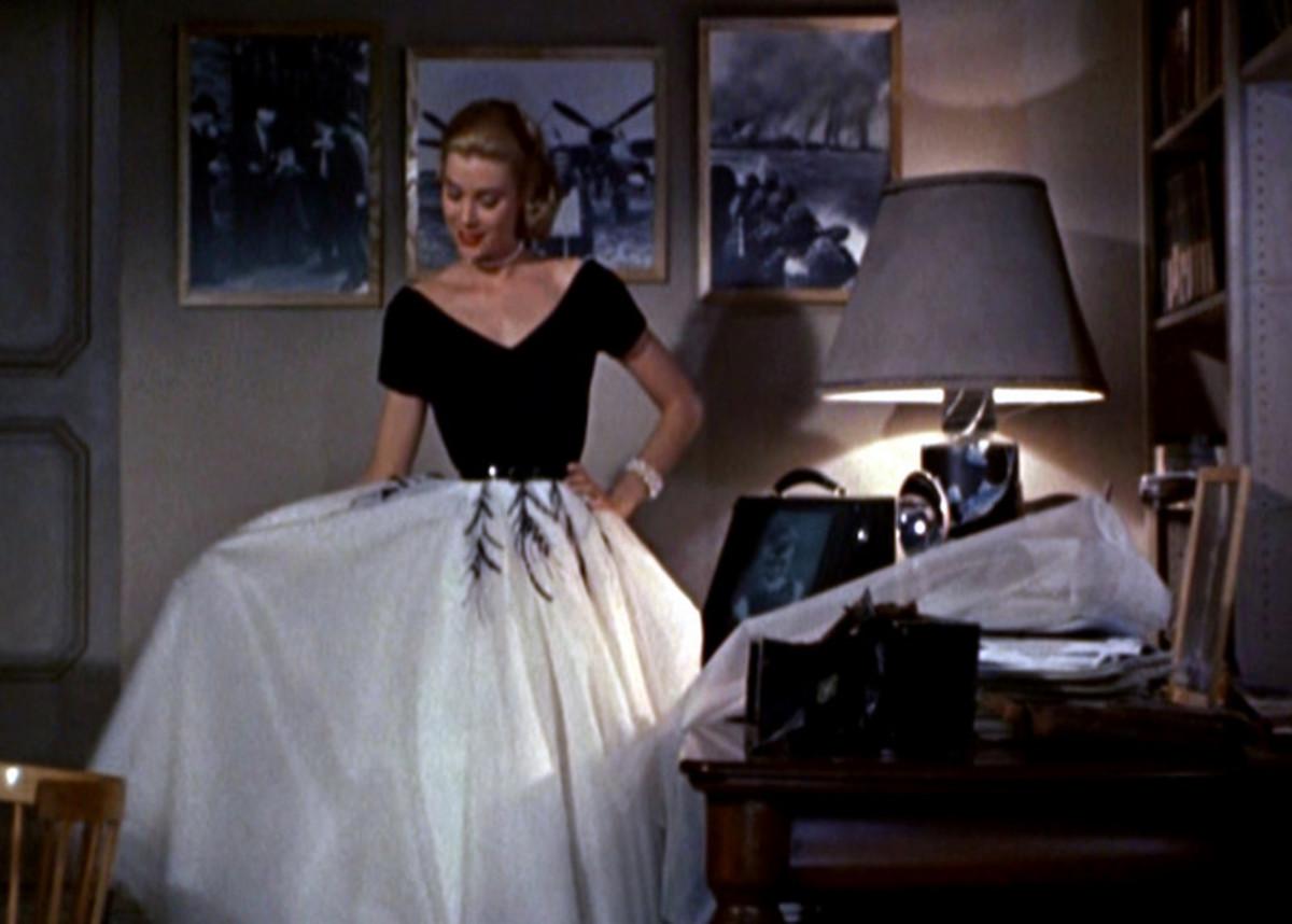 One of my favorites! Grace Kelly in Rear Window! Beautiful dress!