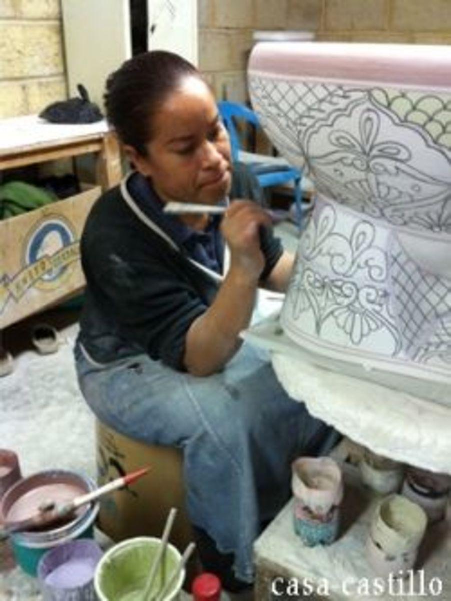 Artist From CasaCastillo.com Painting a Mexican Talavera Toilet