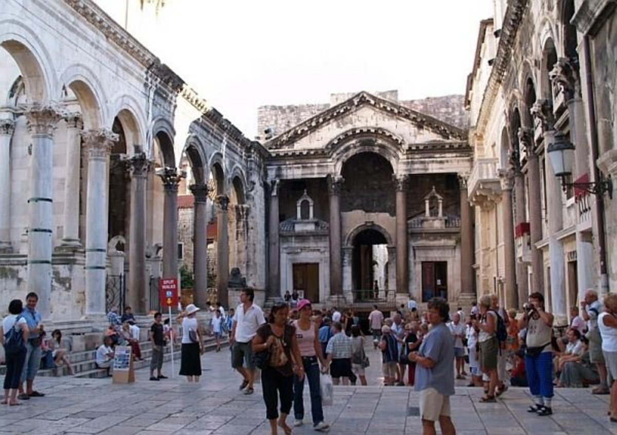 To the left is the Cathedral - to the right is the Temple of Jupiter.  Through the center back wall is the entrance to the Diocletian's chambers.  There are several rose colored columns for the glory of the Emperor.