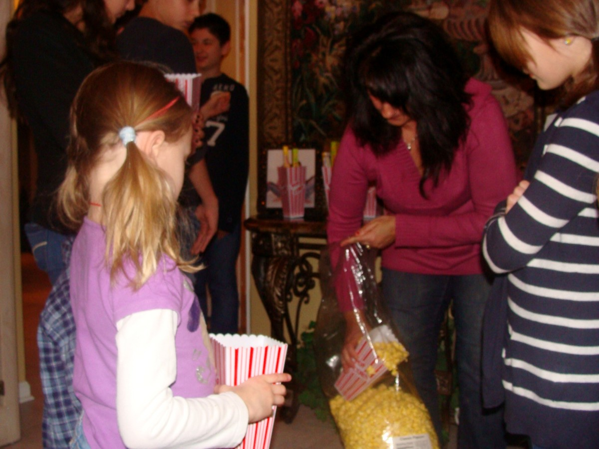 Passing out the popcorn for the movie.  Large bags of popcorn can be found at bulk food stores.