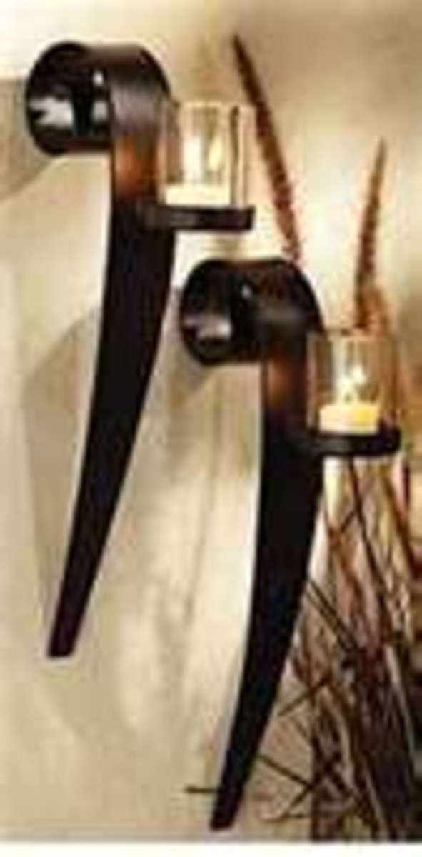 Image credit: http://www.wrought-iron-crafts.com/articles/wroughtiron-wall-candleholders.html
