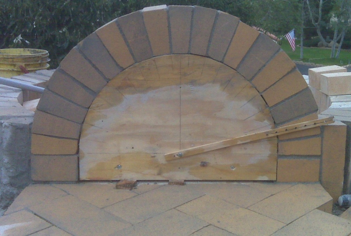 """See also the """"compass"""" made here with a stick  to keep the curve  accurate. Centering should remain in place for at least seven days after construction of the arch and longer in cold weather - Brick Institute of America."""