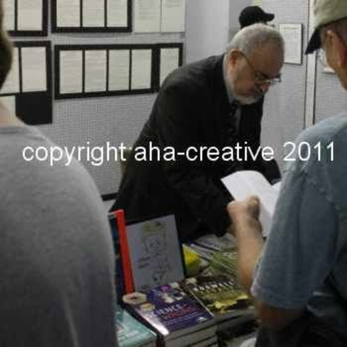 Stanton Friedman signing books at the 2011 Roswell UFO Festival