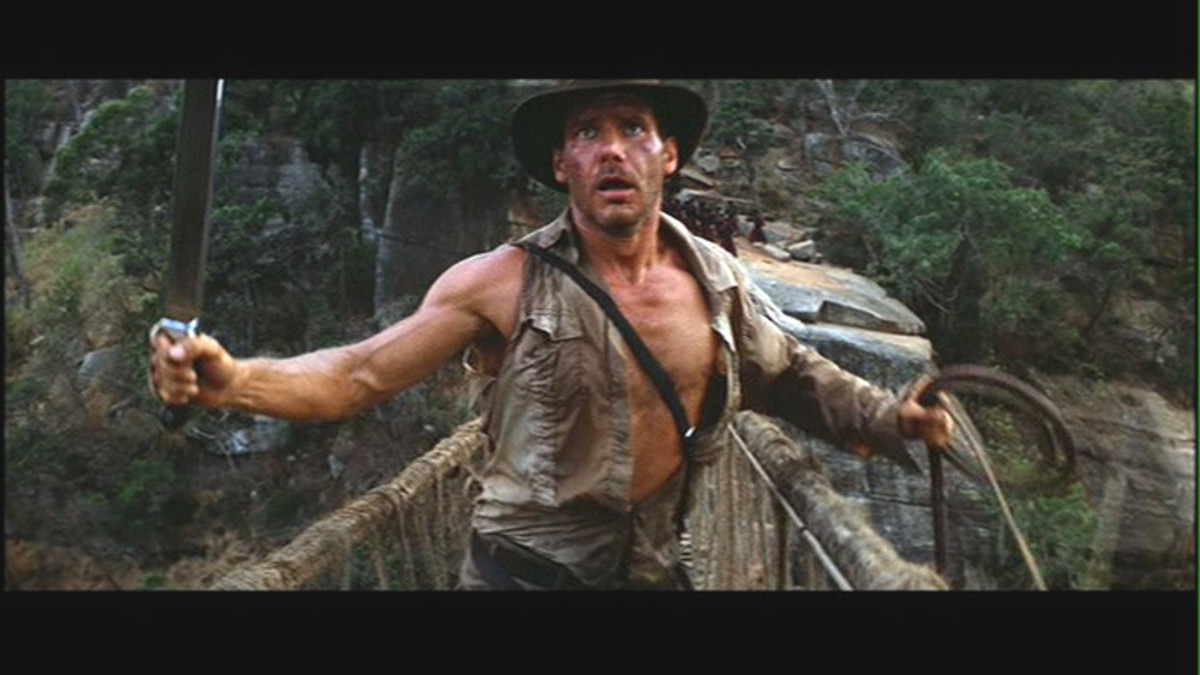 Indiana Jones on a rope bridge over a crocodile infested river