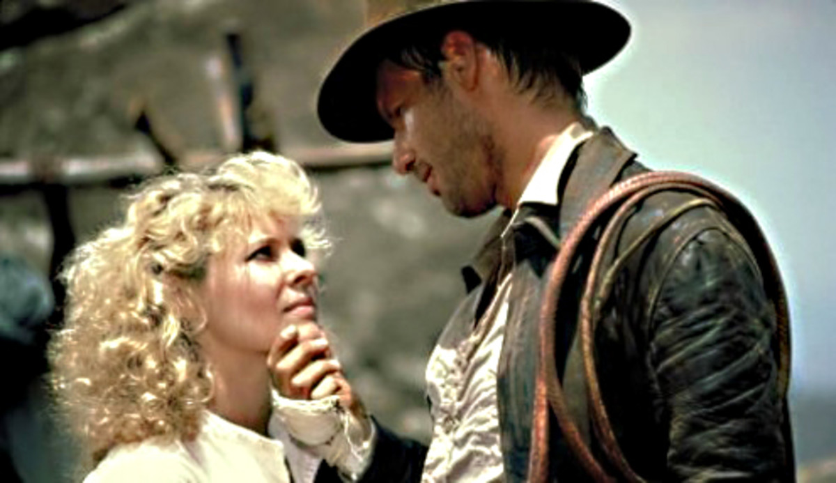 Willie Scott (Kate Capshaw) and Indy (Harrison Ford) share a moment together
