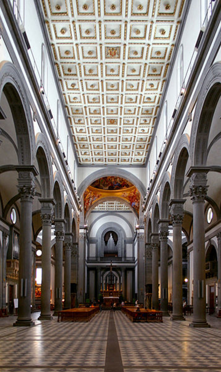 Inside the Church of San Lorenzo, Florence, Italy.  Notice the columns, arches and simple lines.