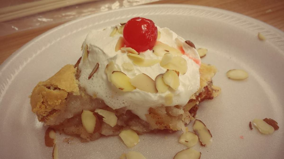 This photo of the Washington apple pie with Oregon cherries and California dairy whipped cream and almonds was taken by Victoria, one of the mothers in our co-op class.