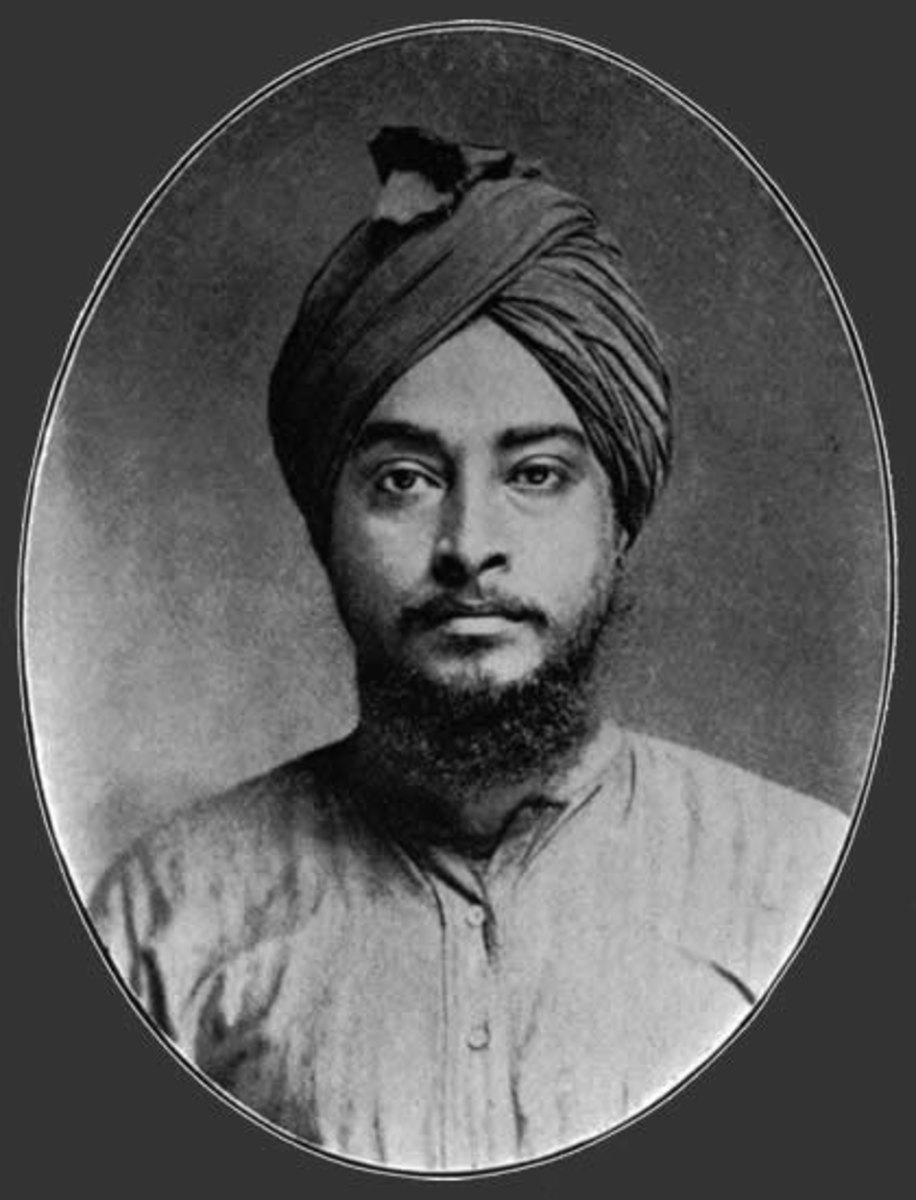 Yogananda's passport photo when he came to America. He shaved his beard on the boat trip when he was told that Americans might accept long hair, and they might accept a beard, but not both!