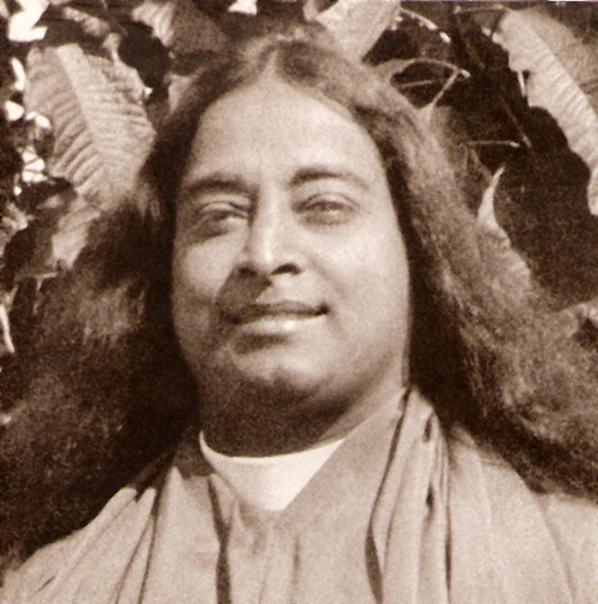 A photo of Yogananda smiling.