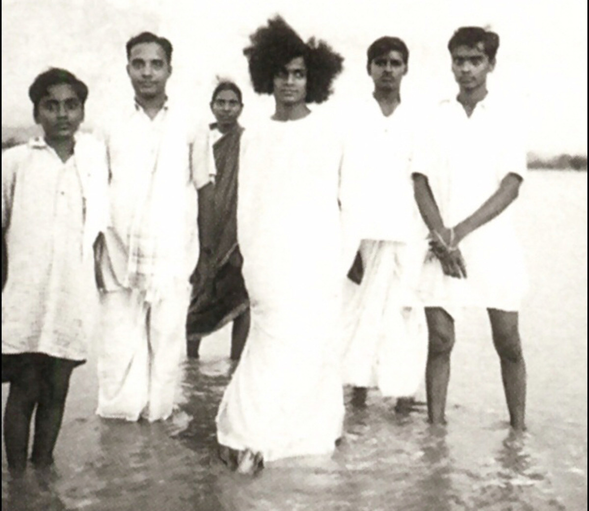 A picture of the young Swami with a few other devotees in the waters of river Chitravati