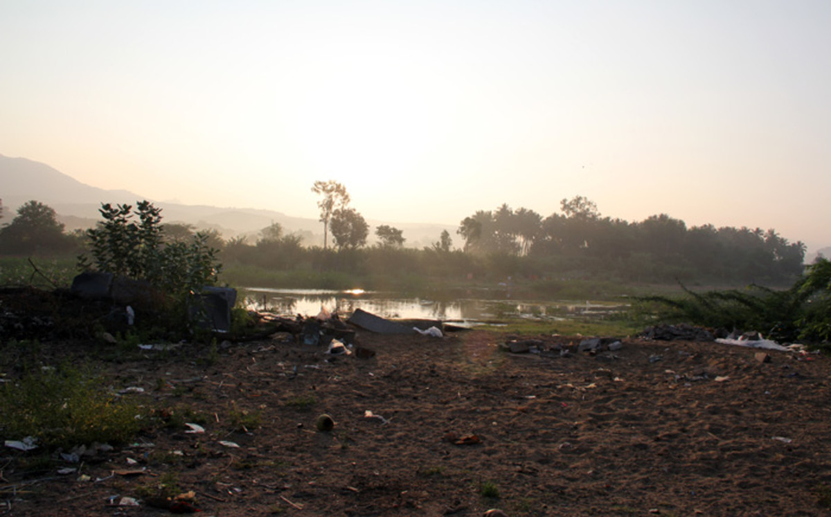 The break of dawn is an awesome sight at river Chitravati. The moment the foreground is seen, it is a painful and dirty sight.