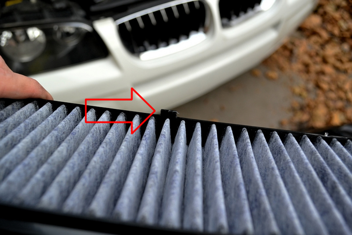To install the new filter make sure the small plastic center tab is up and at the back so that this side goes in first.