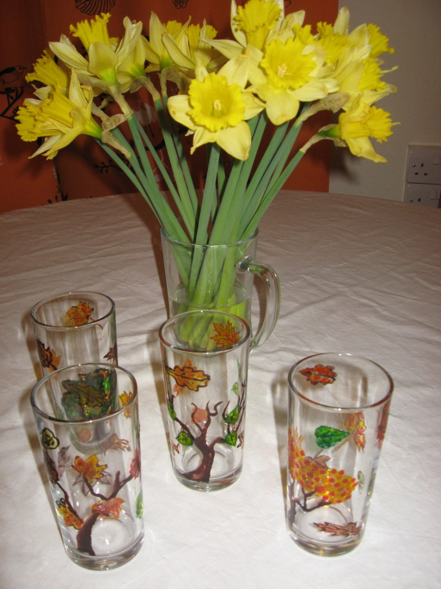 Hand painted drinking glasses set with leaves and trees