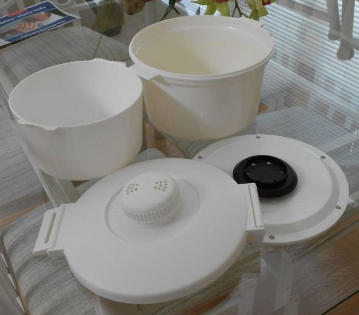 These are the four section of the Nordic Ware Steamer and Cooker