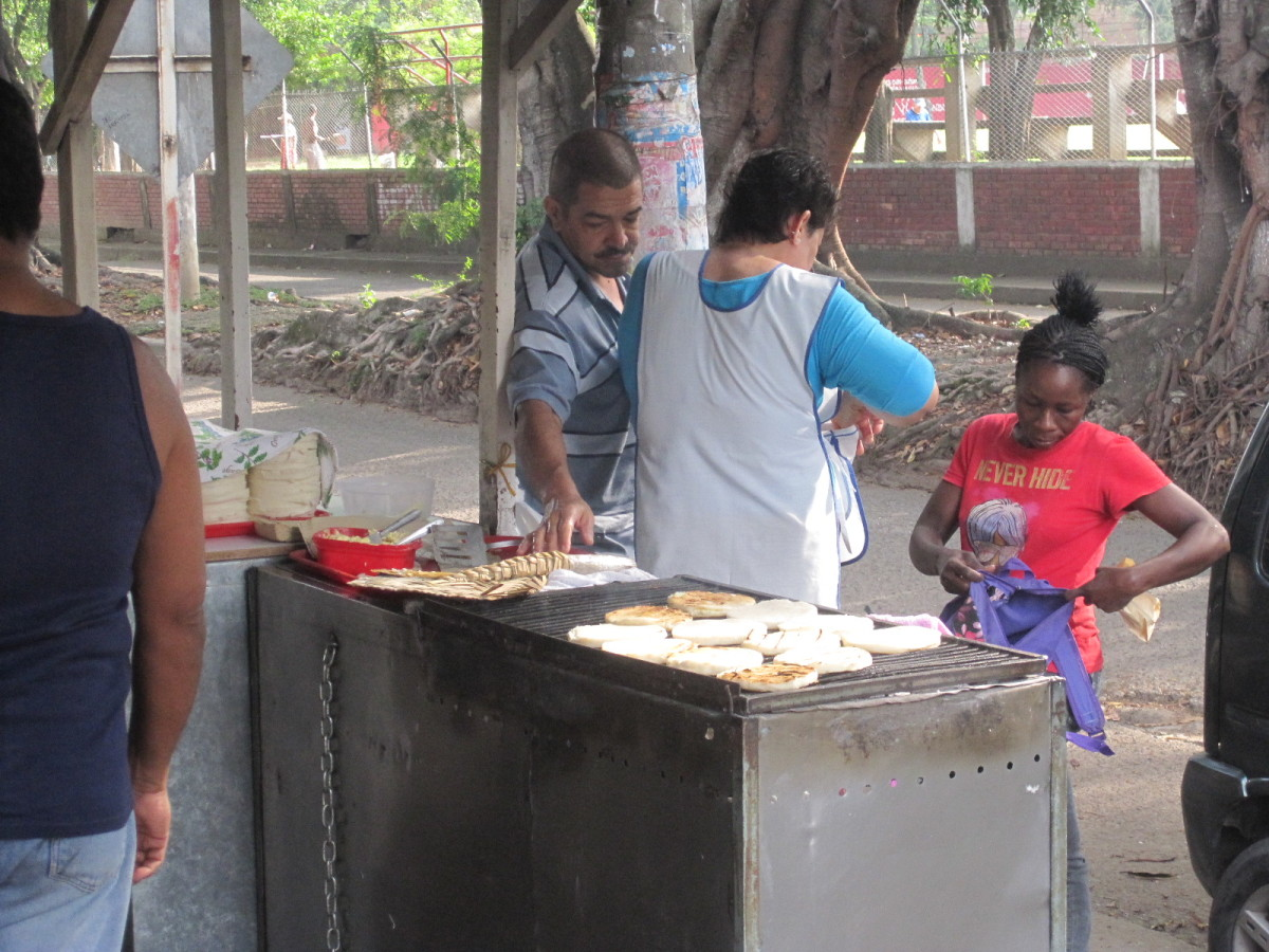 Street vendor selling arepa in the morning