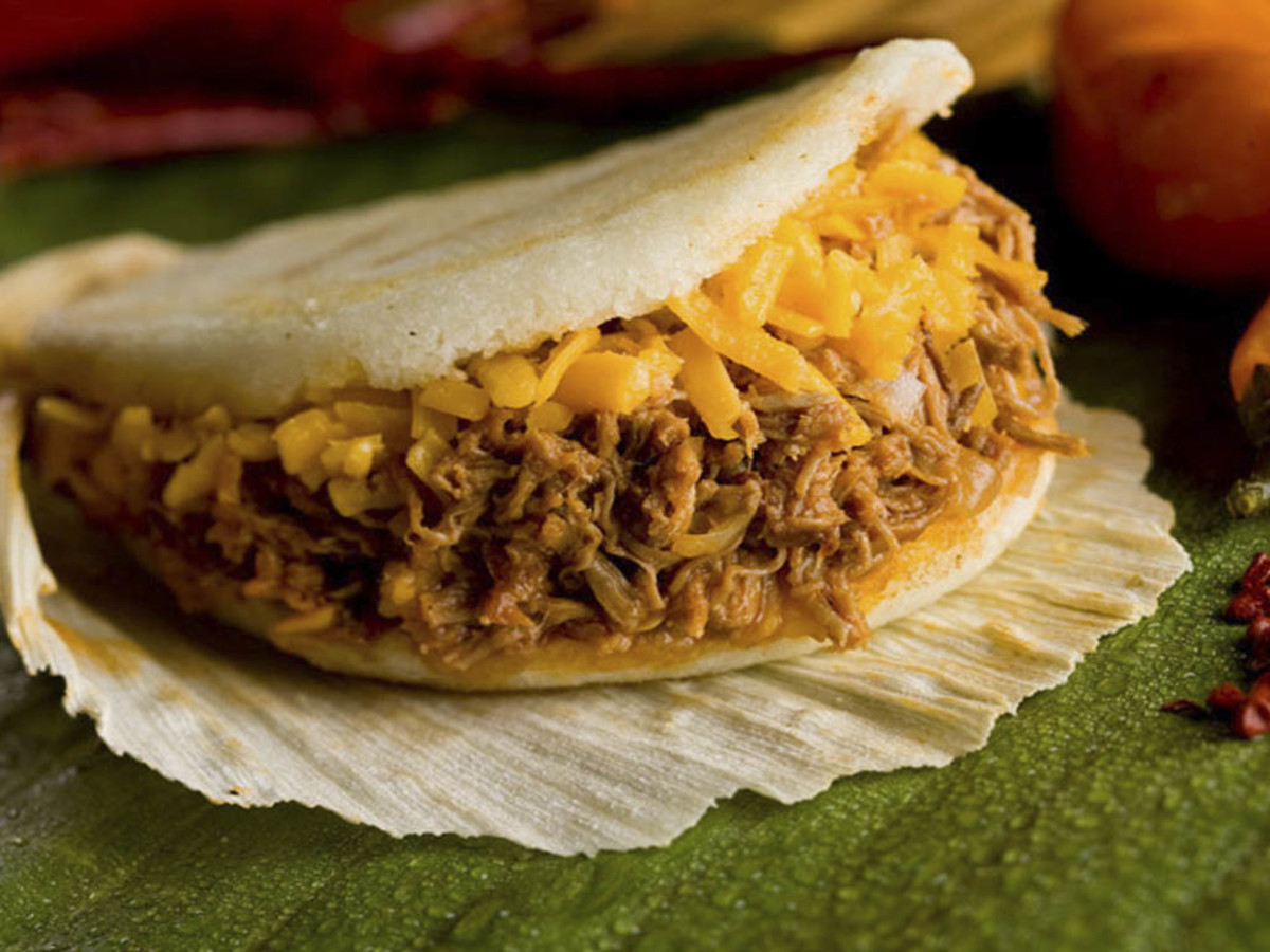 Arepa with shredded pork and shredded cheese