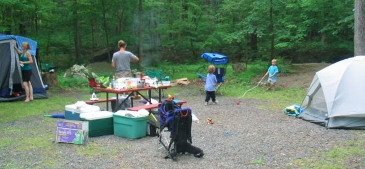Setting up camp while kids play