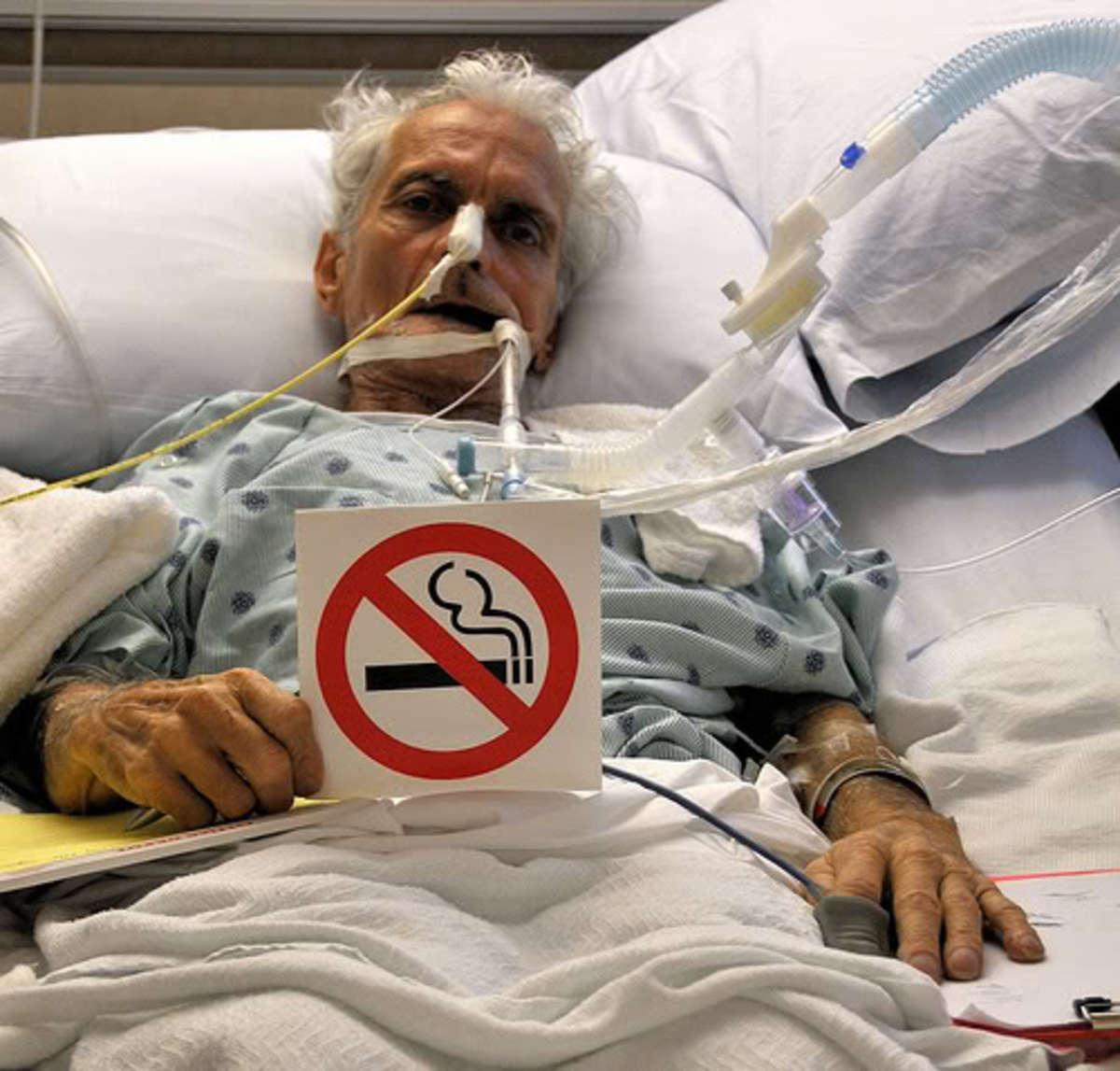 This was the caption that went with this picture:   Last Request; Please Don't Smoke My father asked me to take this picture of him after he regained consciousness in CCU. He lost the fight with lung disease. (Asbestosis, COPD, and Pnuemonia)