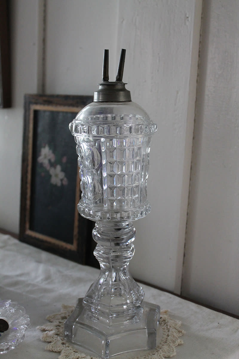 A later version of a whale oil lamp that burned heavy oils such as olive oil.