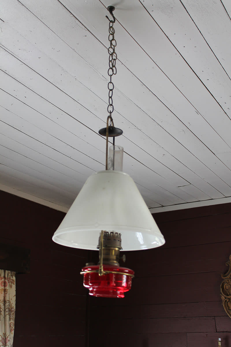 A hanging kerosene lamp used in the middle of the room.