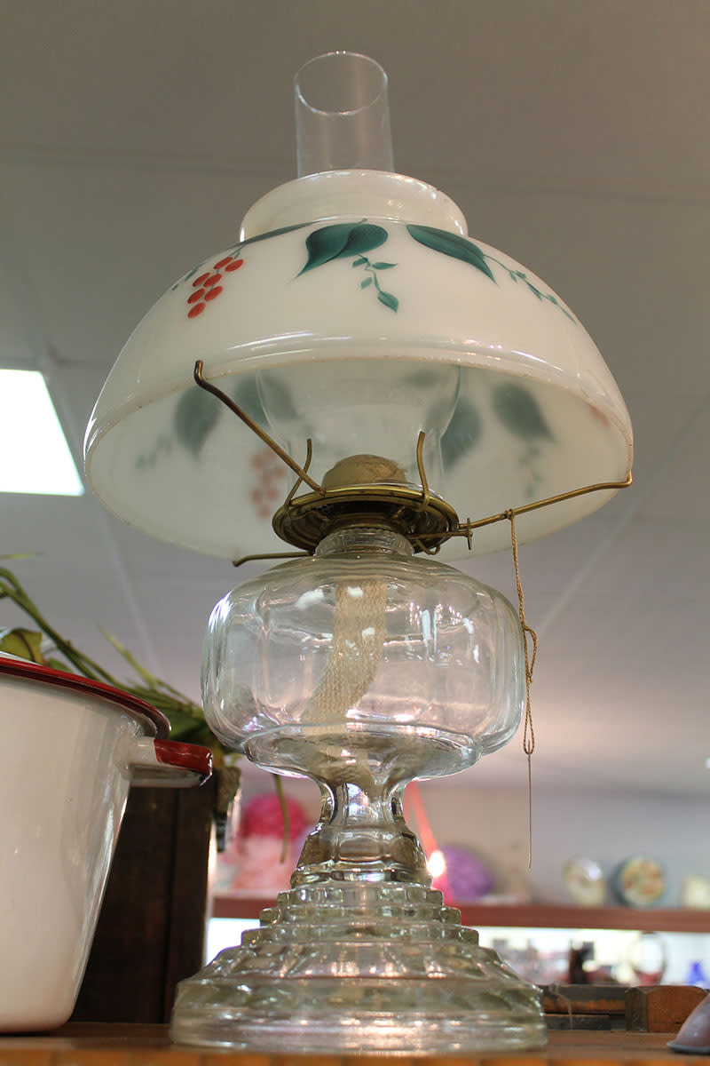 Antique kerosene lamps can be found in most antique stores.