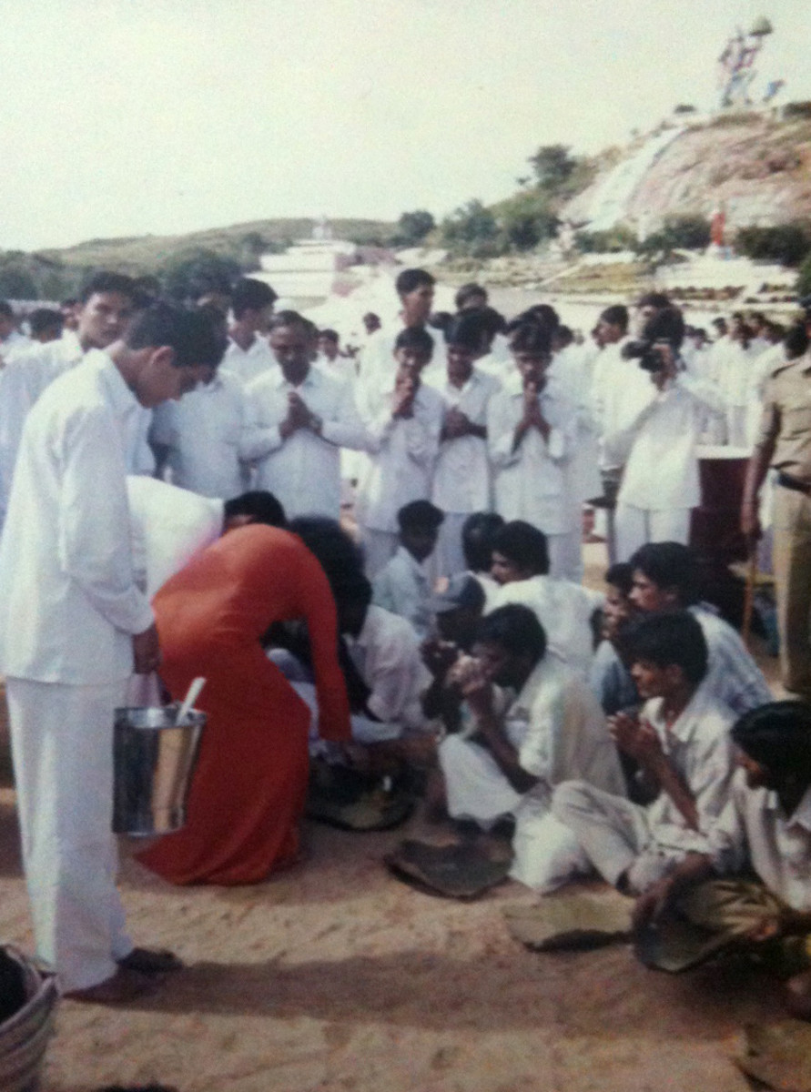 I enjoyed the privilege of taking photos as well on that Narayan Seva day. (Seen in this picture, opposite to Swami with a camera to my face!)