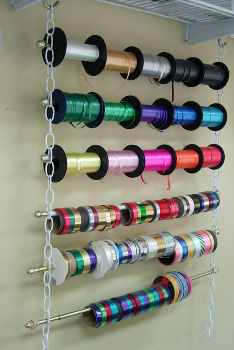 Ribbon is a common embellishment used on cards and paper crafts, With a hook and eye, some plastic link and some dowels, you can store it all in one place.