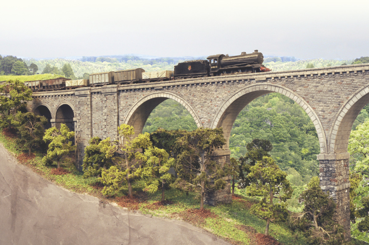 A 'pick-up', branch goods train hauled by LNER Gresley Class J39 returns to Haltwhisle from Alston along branch lines long since ripped up, including this one.